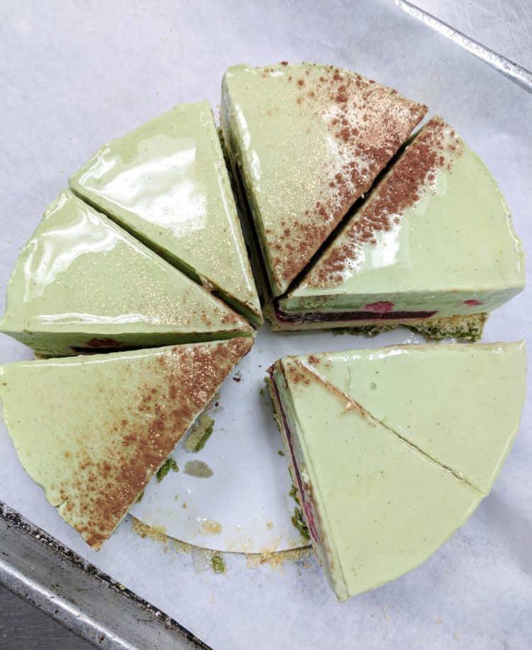 Pistachio raspberry entremet on a cake board