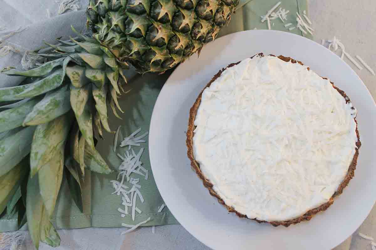 Pineapple coconut tart next to a pineapple