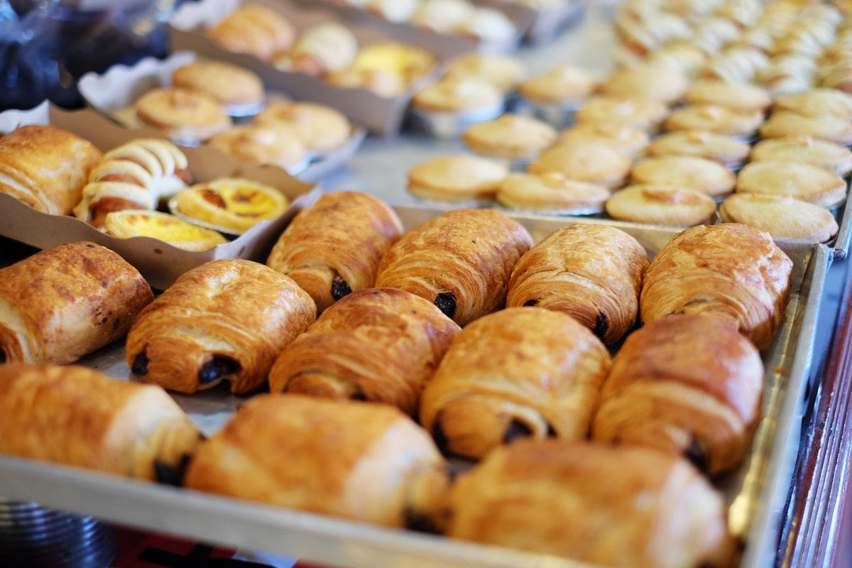 Various trays of croissants and other pastries