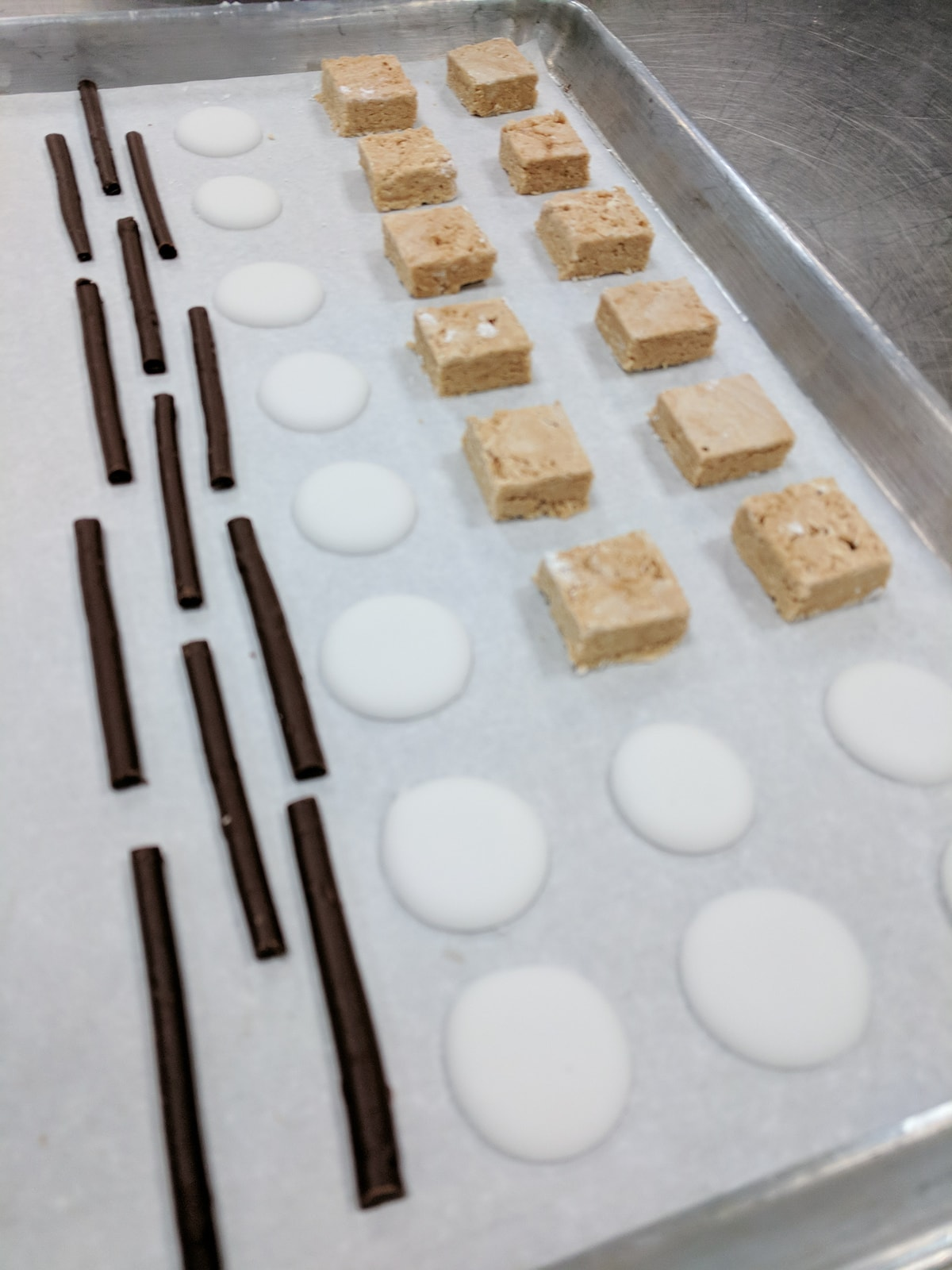 Confections on a sheet tray before being enrobed in chocolate