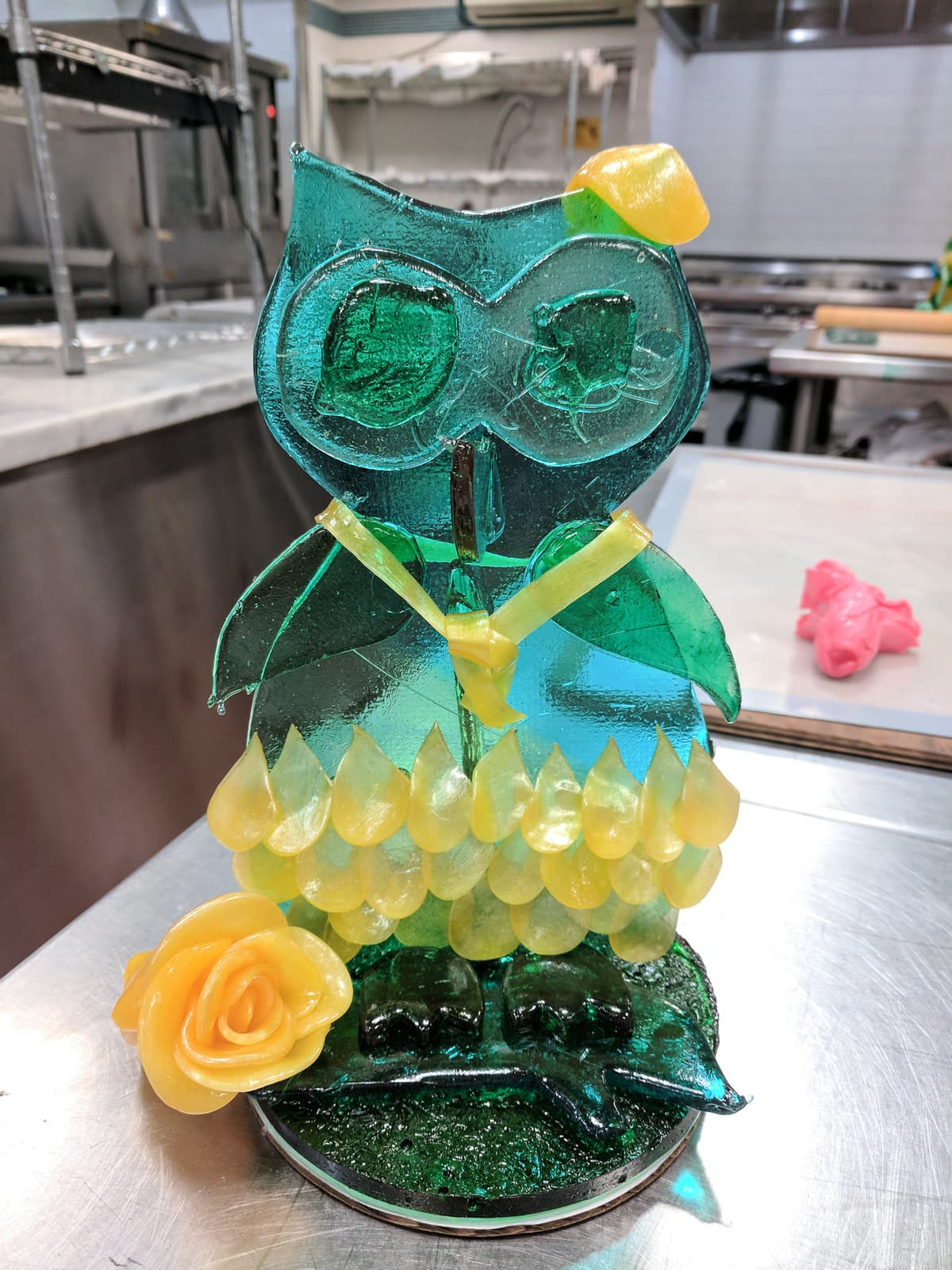 Poured sugar owl with pulled sugar decorations