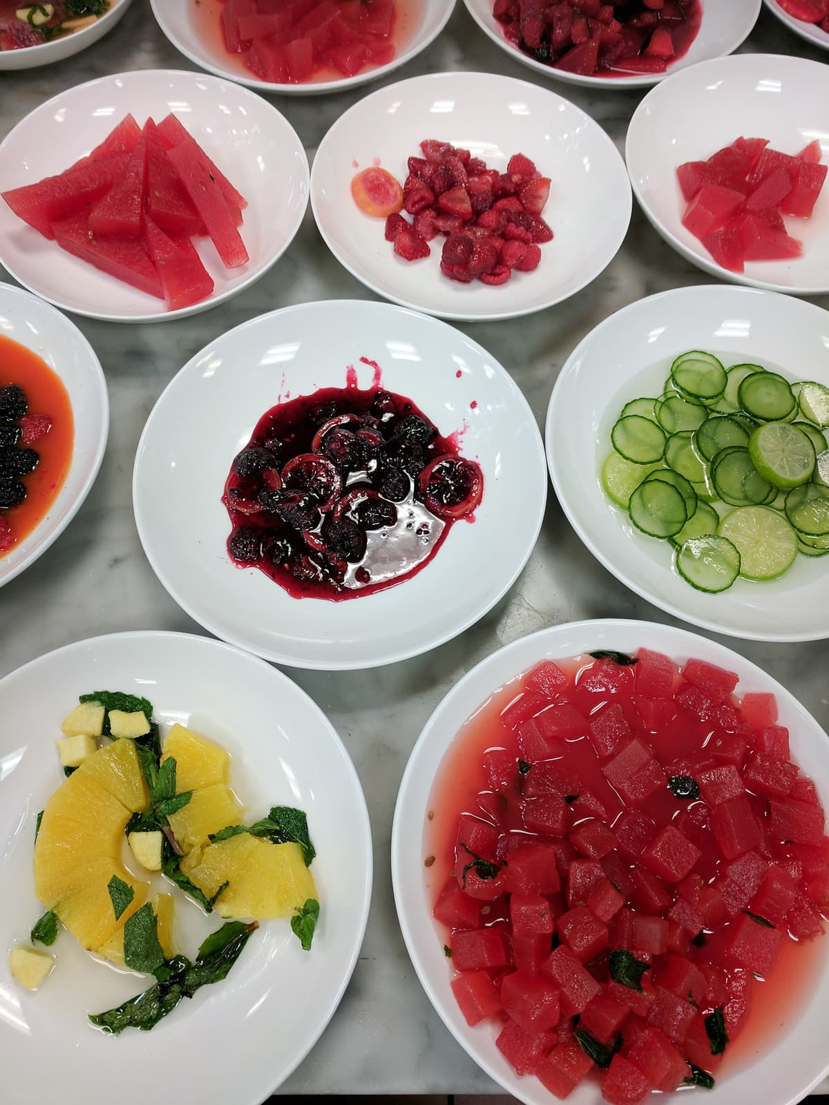 Various bowls of sous vide fruit and vegetables