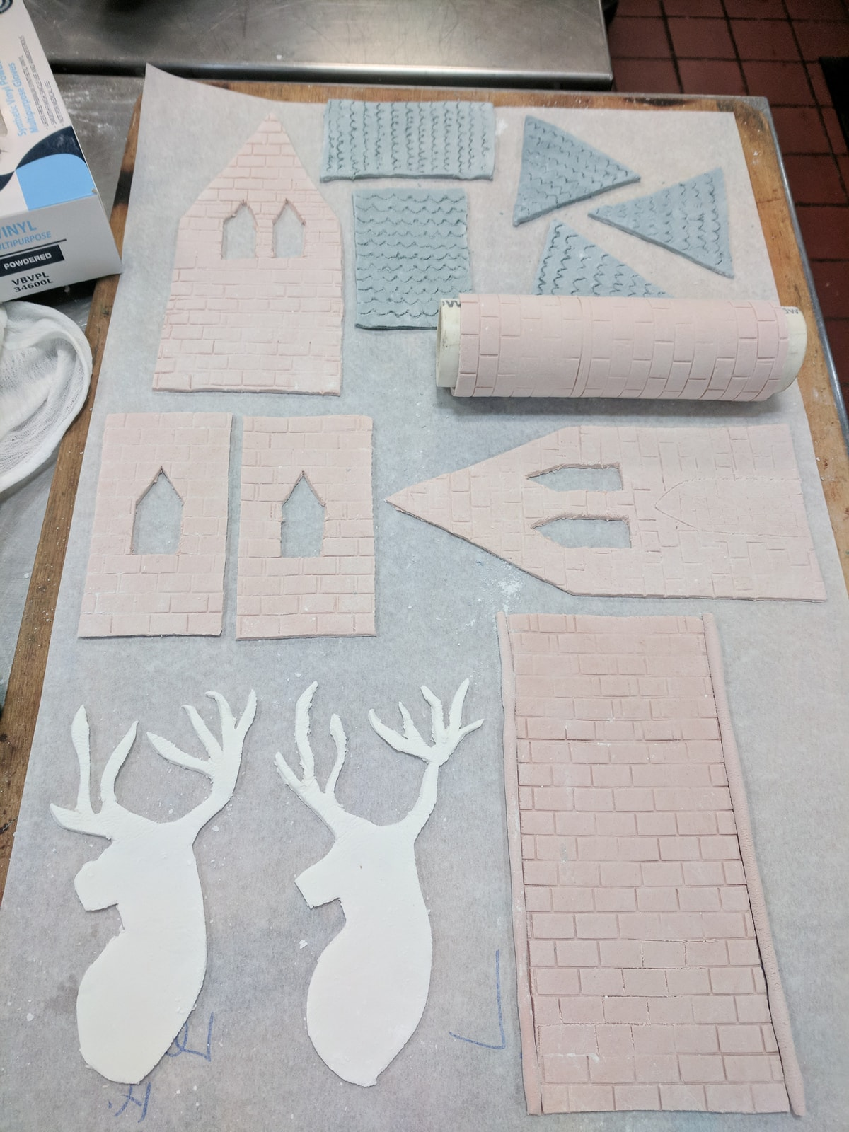 Various pieces of pastillage laid out on a wooden board