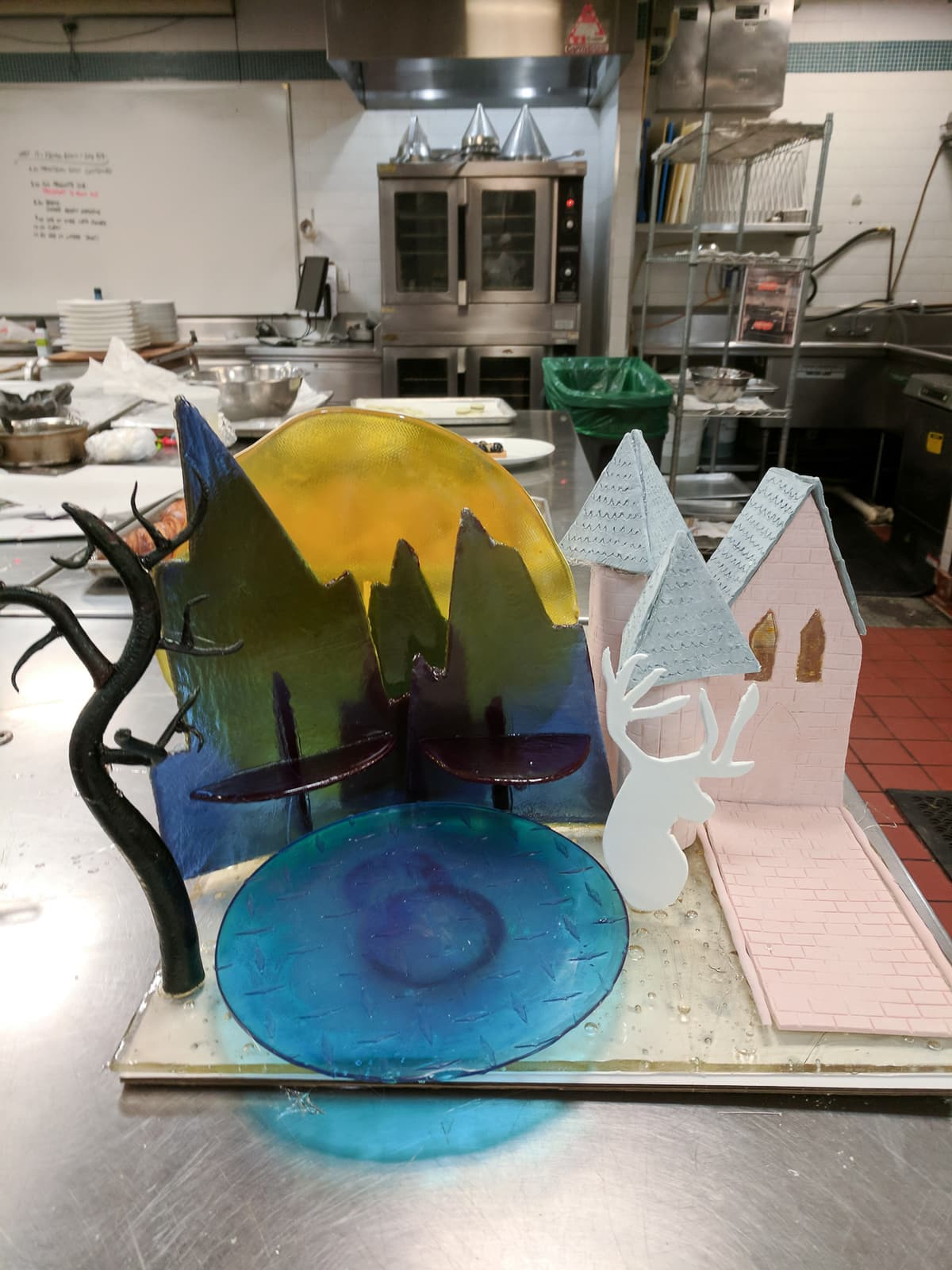 Sugar showpiece with mountains, lake, and castle