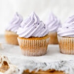 Cake stand topped with Earl Grey lavender cupcakes on a grey napkin