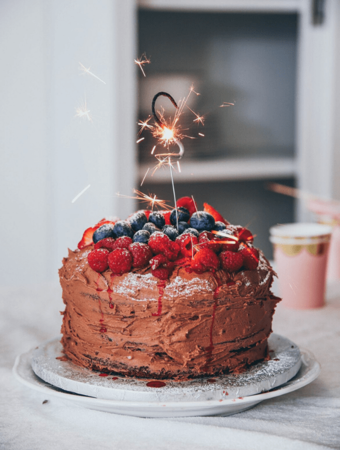 Chocolate cake with berries and a sparkler