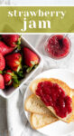 Overhead shot of basket of strawberries, bread with strawberry jam, and jam in a jar that reads 'Strawberry Jam'