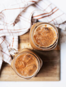 Two glasses of pumpkin cream cold brew viewed from top down