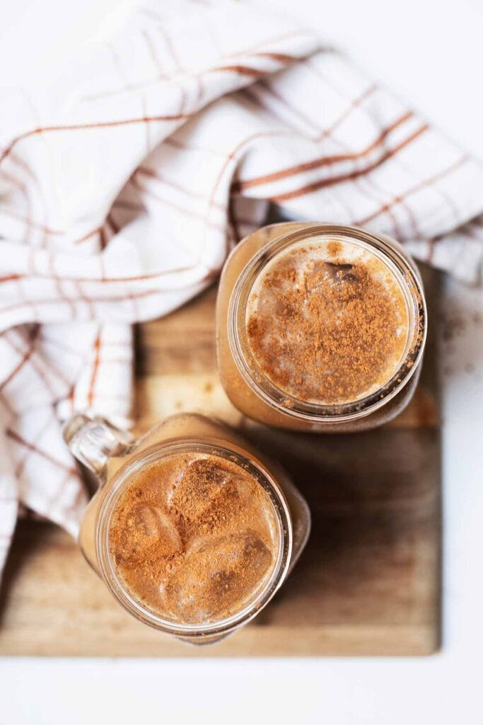 Two glasses of pumpkin cream cold brew as seen from above