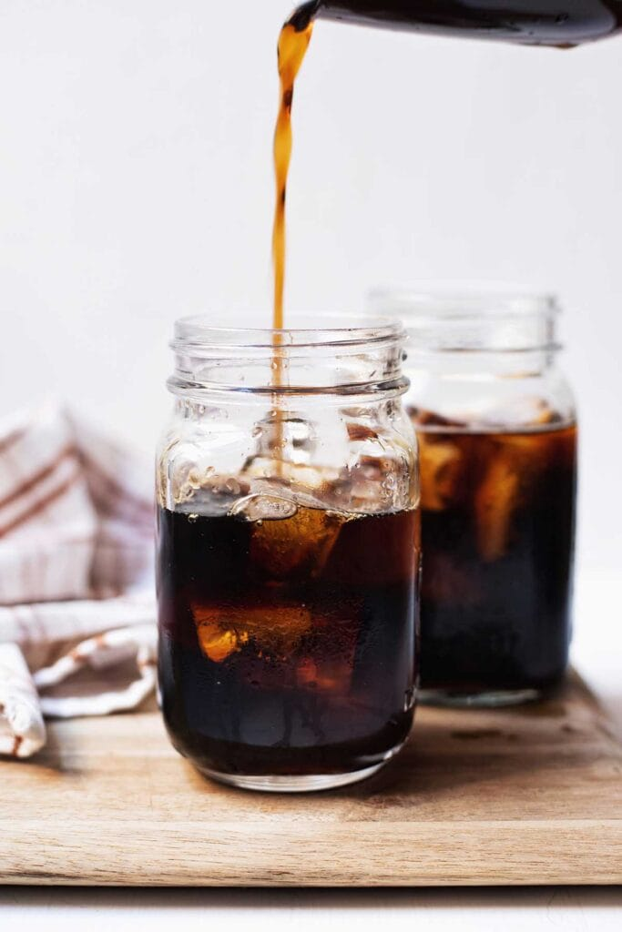 Two glasses of cold brew being poured