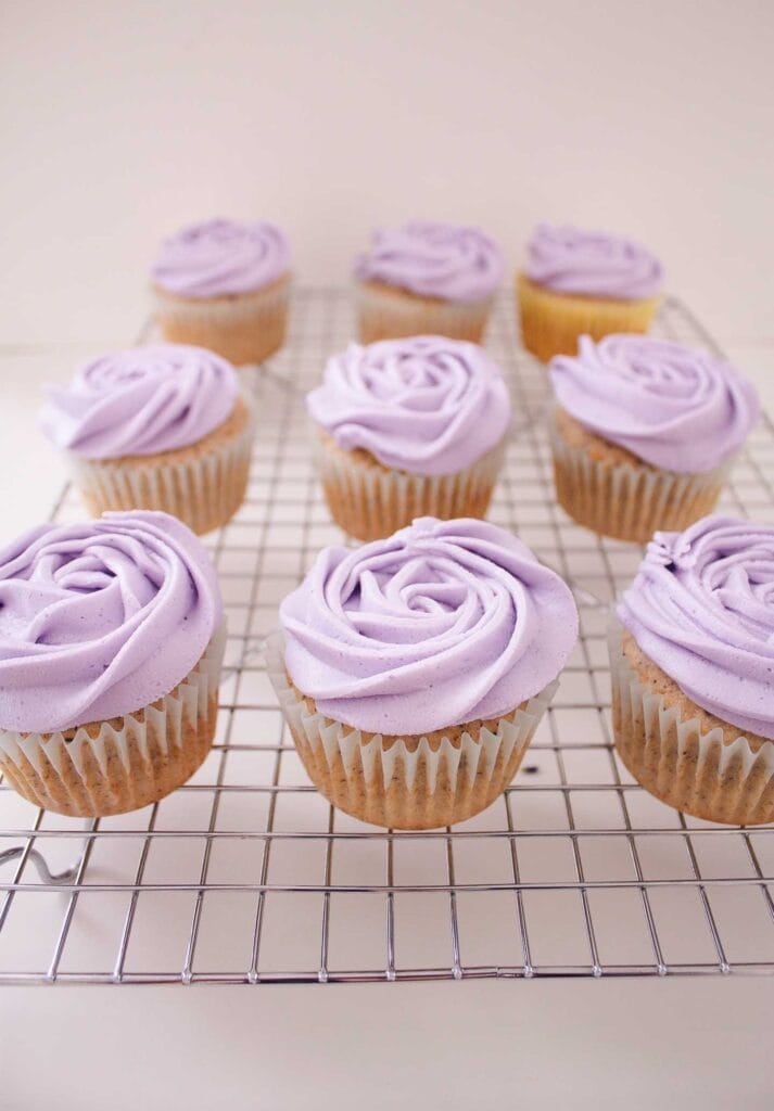 Three rows of Earl Grey and Lavender cupcakes on a cooling rack