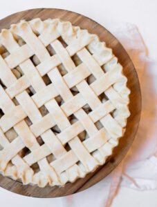 Homemade pie crust with a lattice top viewed from top down