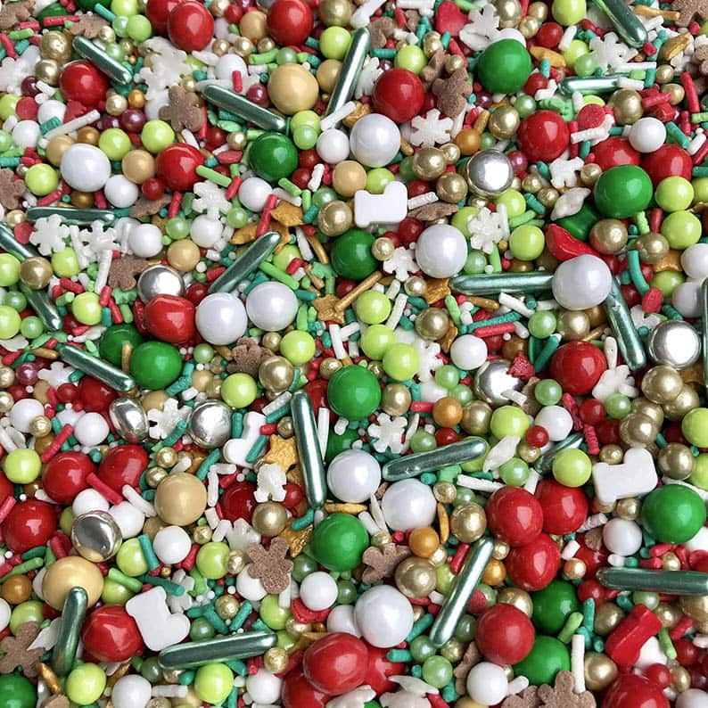 Assortment of red, green, white, and gold Christmas sprinkles