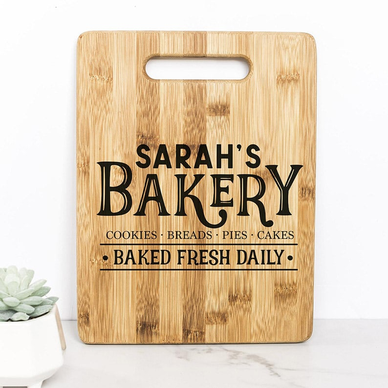 Cutting board that reads 'Sarah's Bakery - Baked fresh daily'