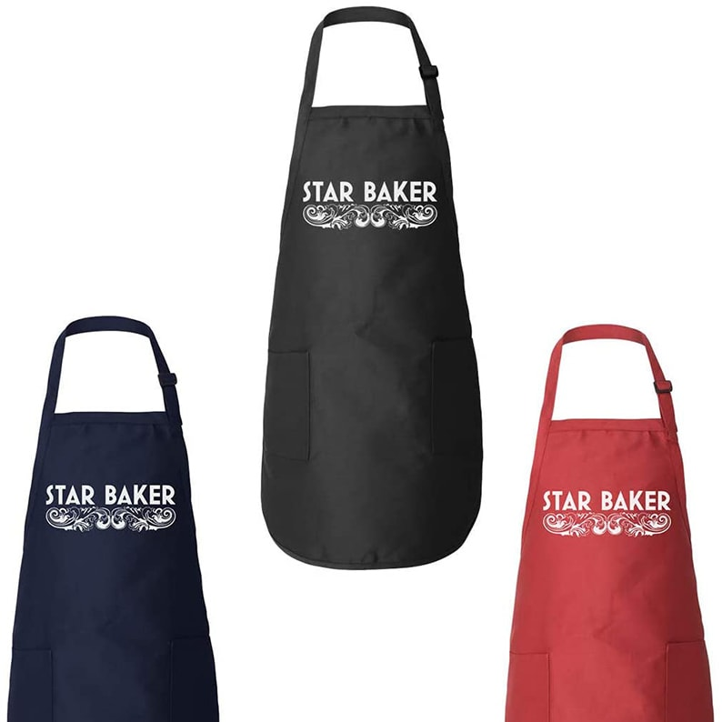 Black, red, and blue aprons that read 'Star Baker'