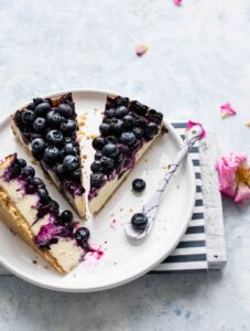 Three slices of blueberry cheesecake on a plate