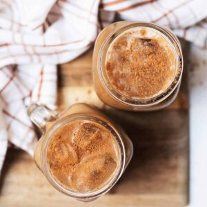 Two glasses of pumpkin cream cold brew viewed from above