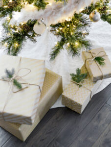 A few wrapped presents under a Christmas tree