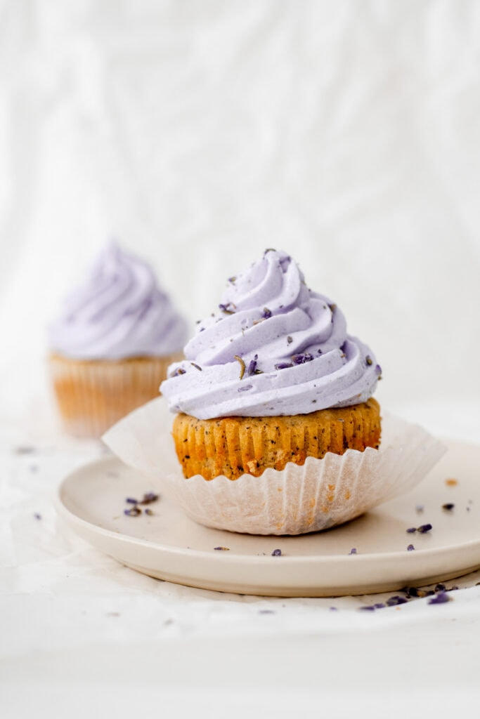 Unwrapped earl grey lavender cupcake on a plate