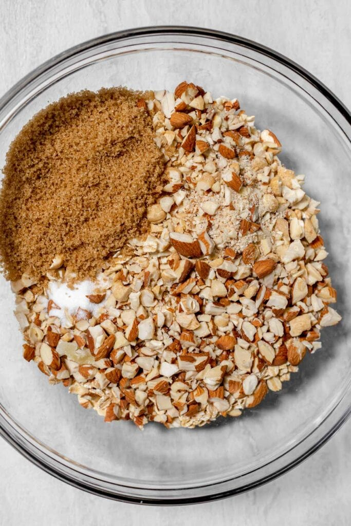 Clear bowl with granola ingredients inside it