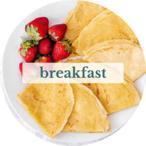 Crepes with strawberries with title that reads 'Breakfast'