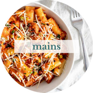 Rigatoni with sausage and peas and title that reads 'Mains'